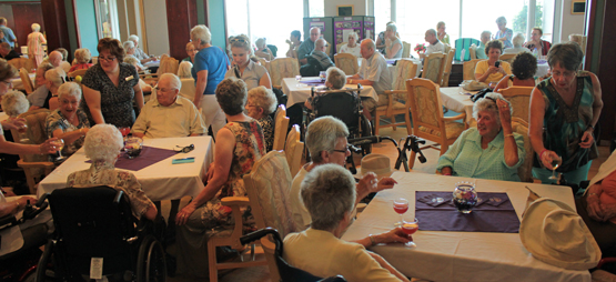 Residents & Guests enjoying Wine & Cheese