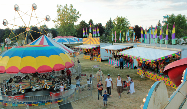 Part of the midway and games of chance area in the east field