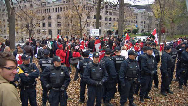 Police form human shield at Canadian Unity Rally in Montreal when separatist agitators arrived on the scene