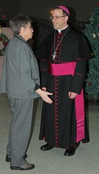 Bishop marcel Damphousse receiving guest