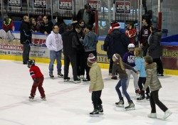 Families joined Bishop Marcel Damphousse for a skate courtesy of the diocese