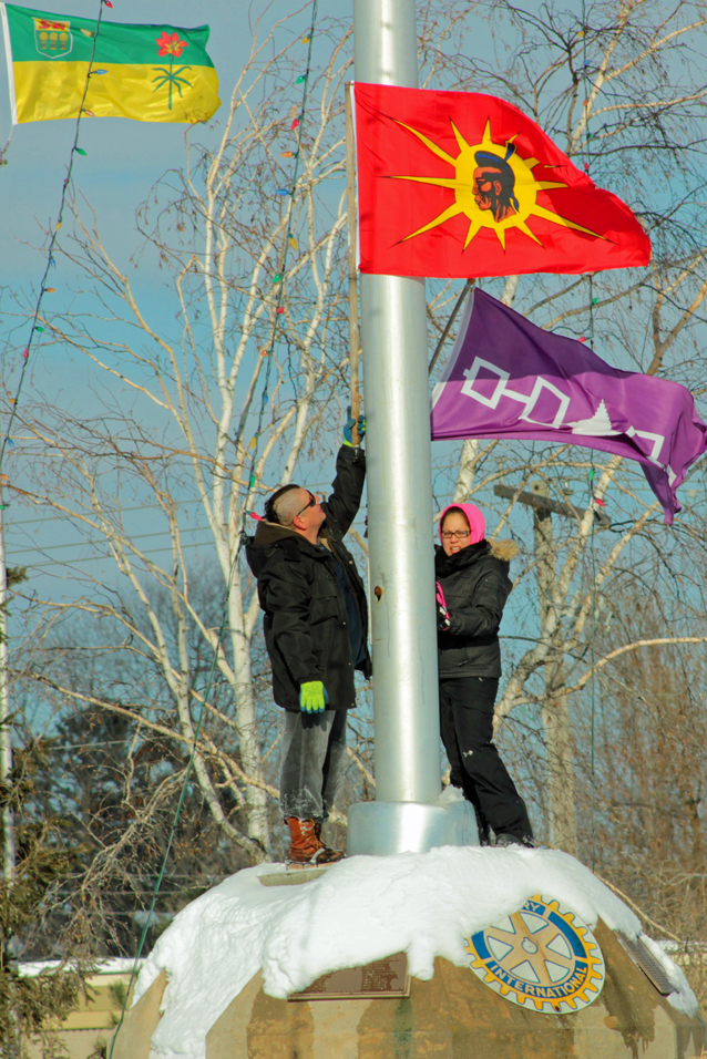 Protestors planting indigenous flags below Canadian flag