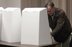 Mark A MacDonald casting his vote.