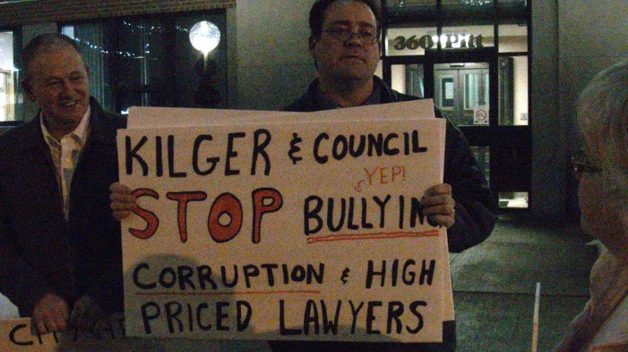 Bob Kilger Hits Panic Button Police Remove Jamie Gilcig from Council Over T Shirt