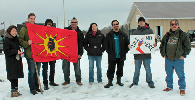 Some Akwesasne Residents and others who came to study the situation pose outside The People's Fire on Cornwall Island