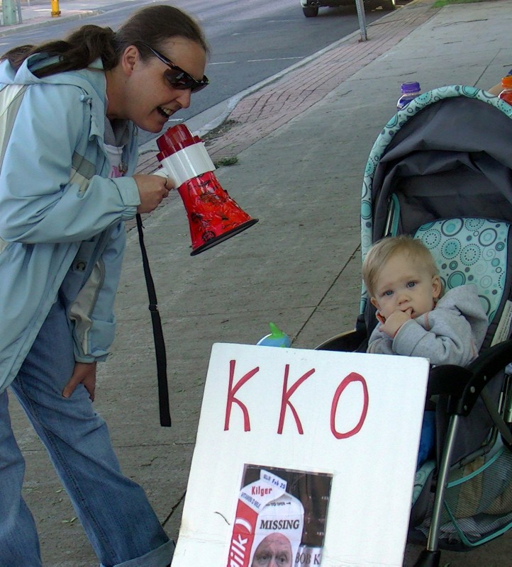 baby protester Kilger sign