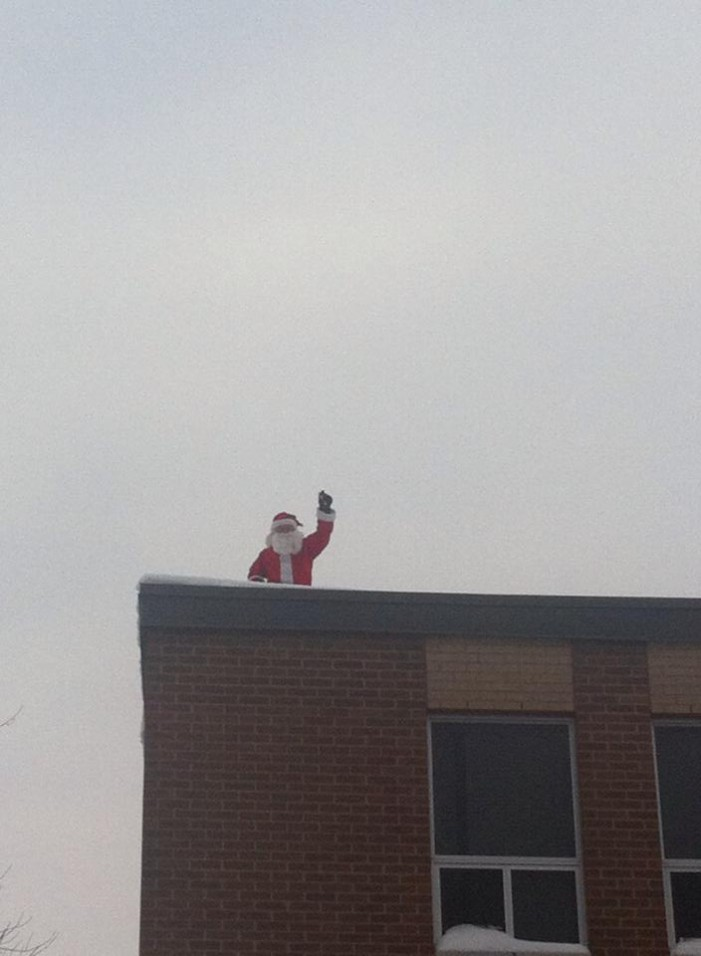 Santa Wearing Shorts & Sandals Over Cornwall Ontario for Christmas 2015 by Jamie Gilcig