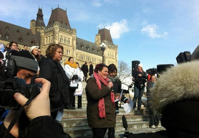 Holly Jarrett speaking on Parliament Hill