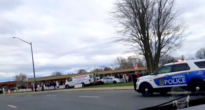 Cornwall Police Stand By as Over 100 #covidiots Protest in Front of EOHU w Kids & Dogs.  By Jamie Gilcig